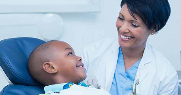 dentist educates parents about pediatric dental care